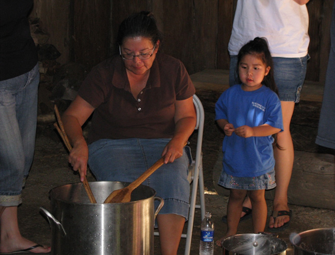 Rhonda Standage passing on the tradition of making acorn soup to her Granddaughter Dora Geisdorff.